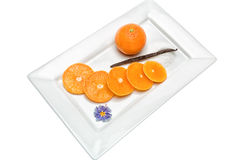 Tangerine with vanilla pod. Citrus fruit has a lot of vitamins and low in calories Royalty Free Stock Images