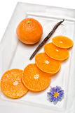Tangerine with vanilla pod. Citrus fruit has a lot of vitamins and low in calories Stock Image