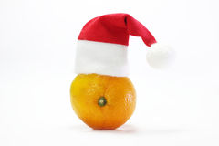 Tangerine on a white background. Beautiful yellow tangerine on a white background wearing Santa Claus hat. waiting for the new year Stock Photography