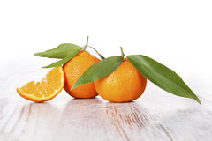 Tangerine on white wooden table. Provence style. Stock Photos