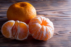 Tangerine on the wooden background Royalty Free Stock Photo