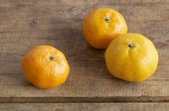 Tangerine on wooden table Royalty Free Stock Image