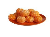Tangerinen auf einer Platte Stockfotos