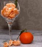Tangerinen in einem Glasvase stockbild