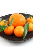 Tangerinen mit Blatt Stockbild
