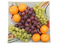 Tangerinen und Trauben in einer Schüssel Lizenzfreies Stockfoto