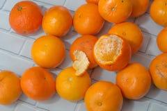 Tangerines σε ένα ελαφρύ υπόβαθρο στοκ εικόνες