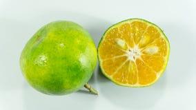 Tangerines и кусок на белой предпосылке Стоковое Фото