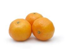 3 tangerines на белой предпосылке Стоковые Изображения