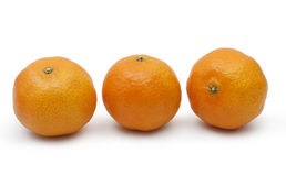 3 tangerines на белой предпосылке Стоковые Изображения RF