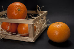 Tangerines на черной предпосылке Стоковые Изображения