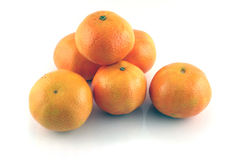 Tangerines 1. Several small tangerines on a white background Stock Photography