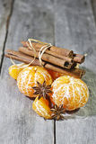 Tangerines with anise and cinnamon. Tangerines without peel with anise stars and cinnamon Royalty Free Stock Image