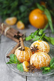Tangerines with anise and mint. Ripe tangerines without peel with anise star, cinnamon and fresh mint. Limited focus Royalty Free Stock Photography