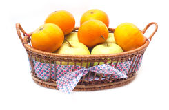 Tangerines and apples in a basket isolated Stock Photo