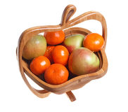 Tangerines and apples in a wooden basket Stock Photos