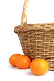 Tangerines on a background of a basket. Tangerines about a basket. A white background Royalty Free Stock Images