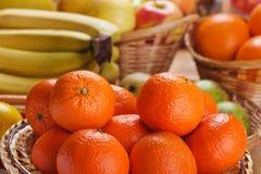 Tangerines, bananas, apples Stock Photography