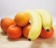 Tangerines and bananas Stock Photo