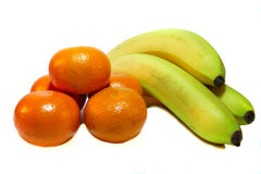 Tangerines and bananas on a white background. Orange tangerine and yellow bananas on a white background Stock Photos