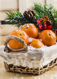 Tangerines in a basket. With Christmas toys and spruce branches Royalty Free Stock Photos