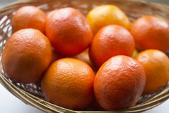 Tangerines in a basket on table Stock Photo