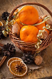 Tangerines in a basket. On a wooden background Stock Photography