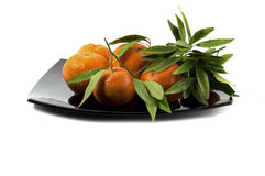 Tangerines on a big black plate Stock Image