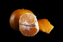 Tangerines on a black background. An image of tangerines on a black background Royalty Free Stock Images