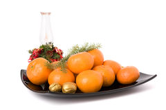 Tangerines on a black plate Royalty Free Stock Images