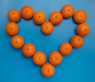 Tangerines on a blue background Stock Photos