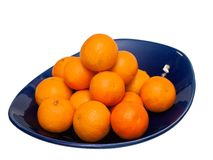 Tangerines on blue plate, isolate Stock Image