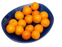 Tangerines on blue plate, isolate Stock Photos