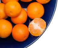 Tangerines on blue plate, isolate Royalty Free Stock Photo