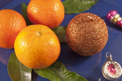 Tangerines on a blue plate Royalty Free Stock Photo