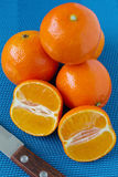 Tangerines on a blue tablecloth Stock Images