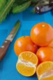 Tangerines on a blue tablecloth Stock Photography