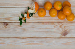 Tangerines on a board with a place for an inscription Royalty Free Stock Photography