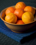 Tangerines In Bowl on Blue Placemat Stock Images