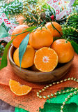 Tangerines in bowl with Christmas decorations Stock Image