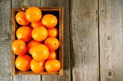 Tangerines in a box Stock Photo