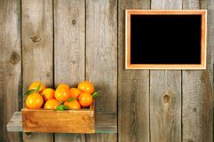 Tangerines in a box Stock Photography