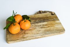 Tangerines with branches on a white background. stock image