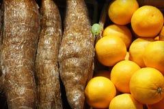 Tangerines and cassava Stock Image