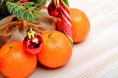 Tangerines, christmas baubles, pinetree Royalty Free Stock Photography