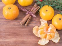 Tangerines with christmas branches and cinnamon stics stock photos