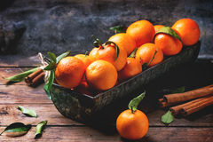 Tangerines with cinnamon Royalty Free Stock Photography