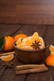 Tangerines with cinnamon stick and anisetree. On old wooden table Stock Image