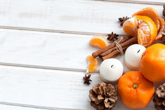 Tangerines, cinnamon sticks, star anise and candle - Christmas m Stock Photo