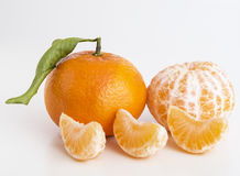 Tangerines or clementines fruits and peeled segments Royalty Free Stock Image